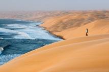 Hiker in sand dunes, Namib-Naukluft National Park, Namibia