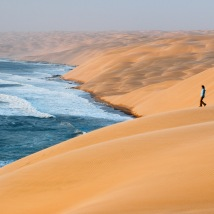 Hiker in sand dunes, Namib-Naukluft National Park, Namibia